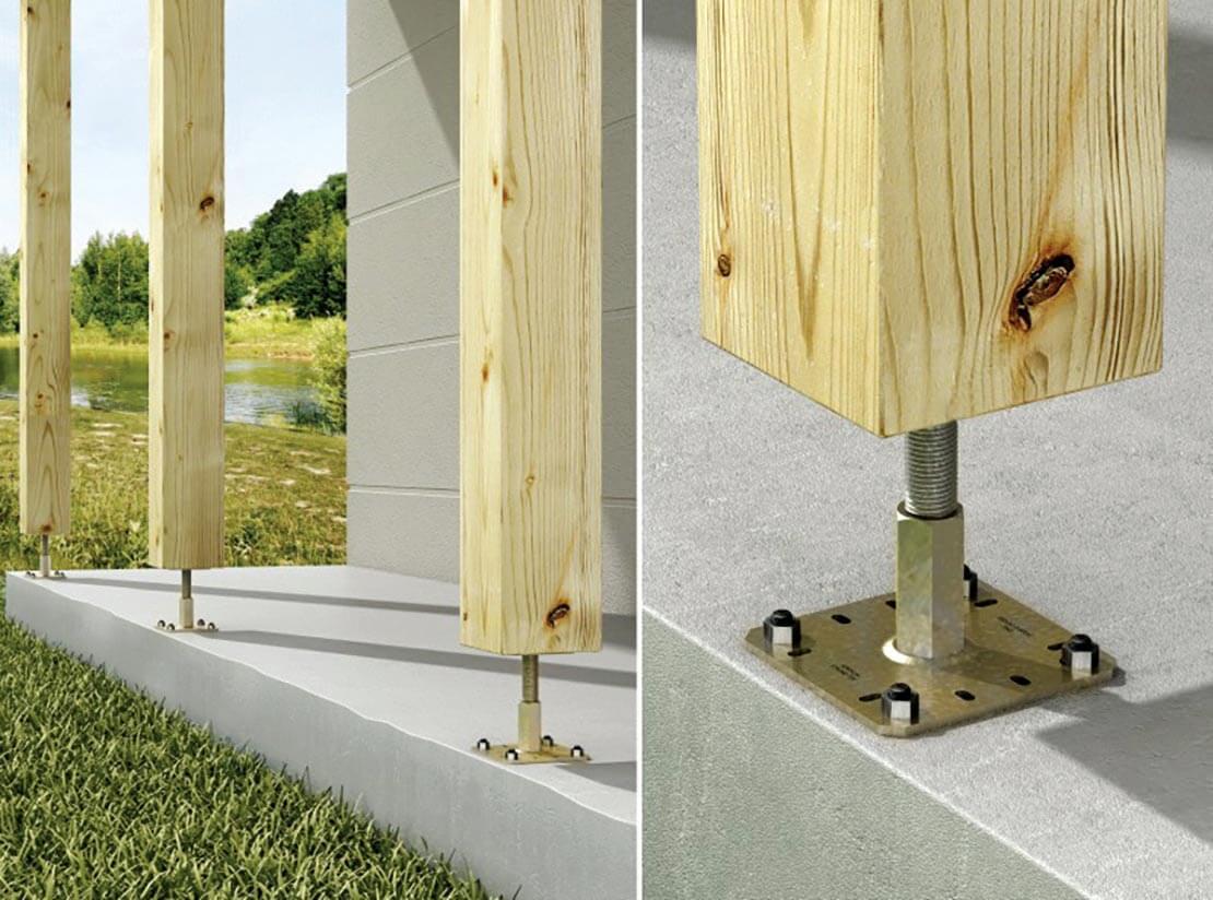 Zdj. 3. Podstawy zapewniające odizolowanie słupa od fundamentu. Regulowane podstawy drewnianych słupów